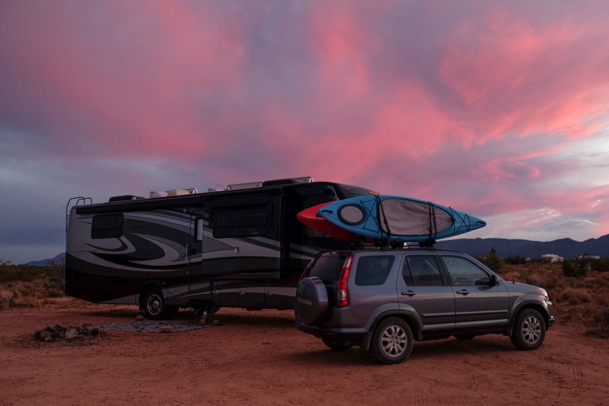 Our RV home on wheels and tow vehicle at a campsite near Sedona, Arizona.